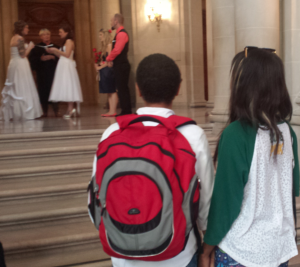 Mari and Cara watch on at San Francisco City as another couple gets married